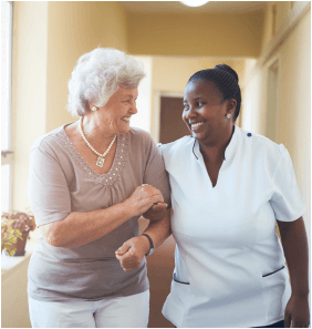 senior woman and caregiver are happily walking in the aisle